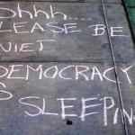 Quiet, Please! Democracy Is Sleeping!